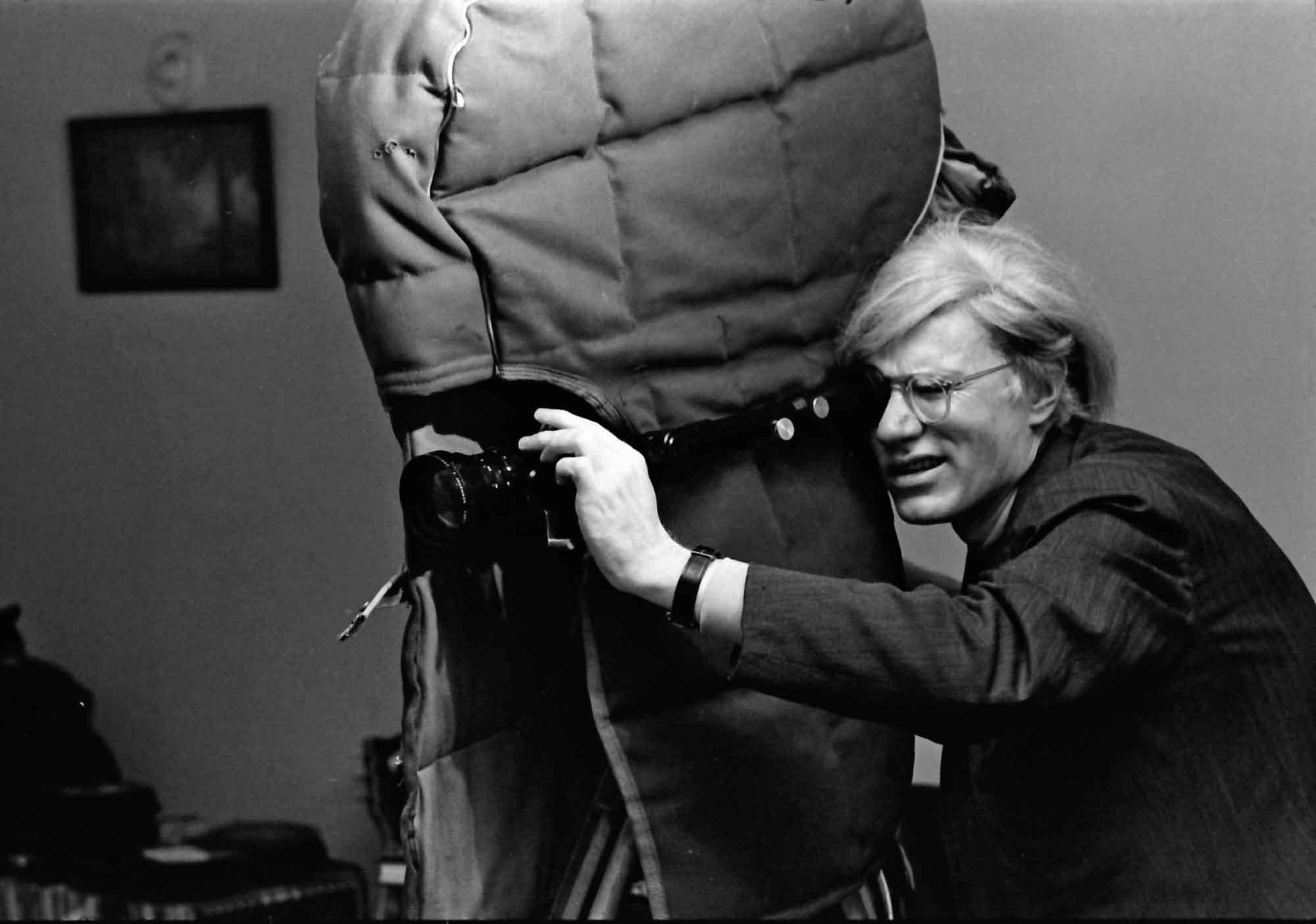 Andy Warhol operating a camera