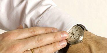 man wearing strap watch