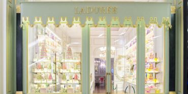 Ladurée beckons with a charming facade outfitted in French decor