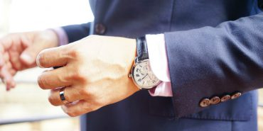 Christopher Lee wearing Drive de Cartier watch